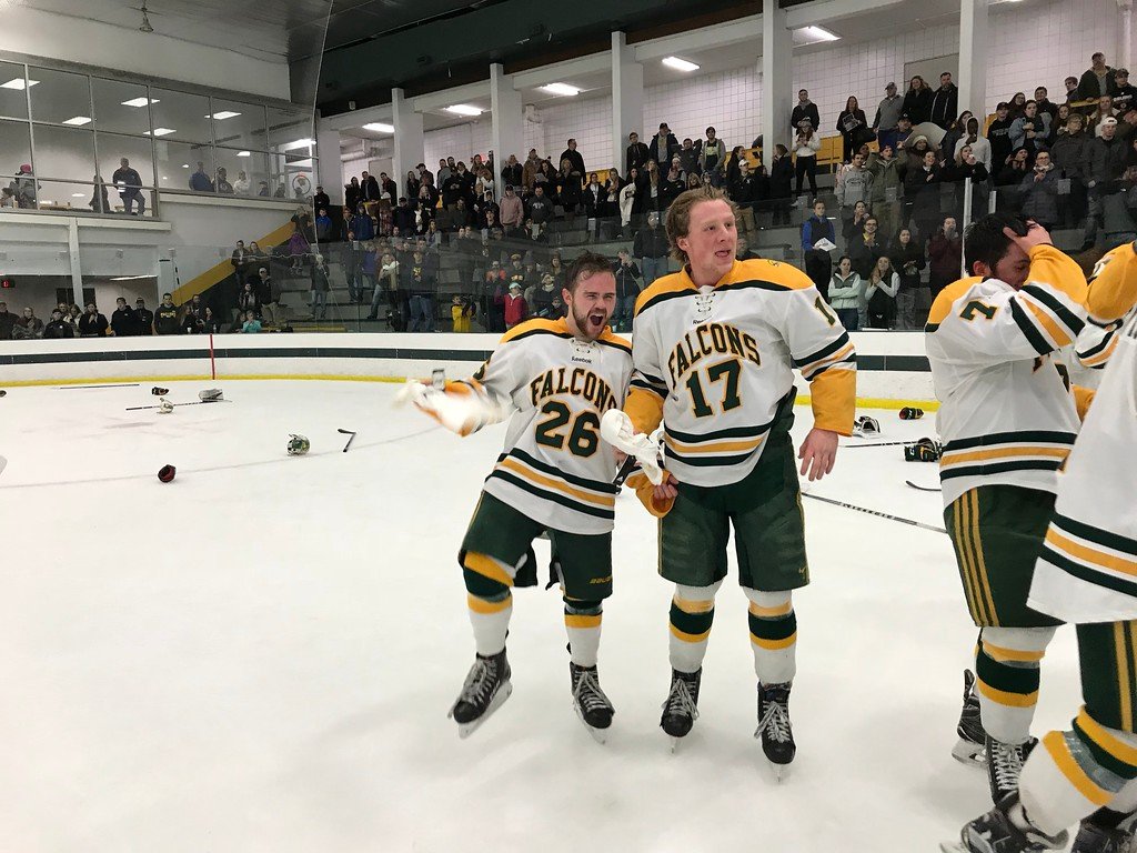 . Fitchburg State\'s Patrick Germain (26) and Kevin Perry (17) celebrate on the ice following Saturday\'s 2-0 win over UMass Dartmouth in the championship game of the MASCAC postseason tournament at the Wallace Civic Center in Fitchburg on Saturday, March 3, 2018. SENTINEL & ENTERPRISE / NICK MALLARD