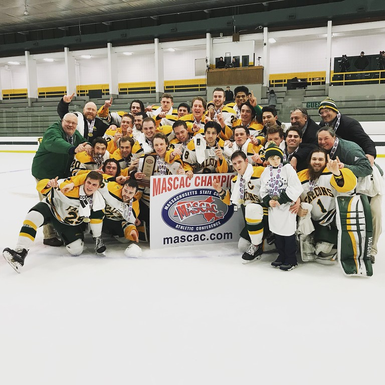 . Fitchburg State University men\'s hockey players and coaches celebrate on the ice following Saturday\'s 2-0 win over UMass Dartmouth in the championship game of the MASCAC postseason tournament at the Wallace Civic Center in Fitchburg on Saturday, March 3, 2018. SENTINEL & ENTERPRISE / NICK MALLARD