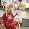 Fitchburg State University womens basketball played Worcester Polytechnic Institute on Thursday night, Nov. 21, 2019 in Fitchburg. FSU's #22 Catherine Coppinger shots over WPI's #31 Bailey Savage. SENTINEL & ENTERPRISE/JOHN LOVE