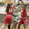 Fitchburg State University womens basketball played Worcester Polytechnic Institute on Thursday night, Nov. 21, 2019 in Fitchburg. FSU's #22 Catherine Coppinger tries to get by WPI's #44 Maddie Blake and #11 Spencer Vinson during action early in the game. SENTINEL & ENTERPRISE/JOHN LOVE