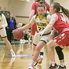 Fitchburg State University womens basketball played Worcester Polytechnic Institute on Thursday night, Nov. 21, 2019 in Fitchburg. FSU's #22 Catherine Coppinger tries to get by WPI's #44 Maddie Blake during action early in the game. SENTINEL & ENTERPRISE/JOHN LOVE
