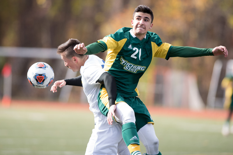 Fitchburg State Freshman Matthew Krikorian of Groton MA heads the ball back to mid field with defense by Worcester State Senior Noah Phelps during Sunday's play off finals between Fitchburg State at Worcester State.  Sentinel & Enterprise photo/Jeff Porter