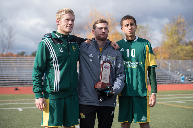 Fitchburg State Freshman captiains Nick Masley, Jared Burns and Steven Martinez accept the second place trophy for the MASCAC finals after Sundays 4-2 loss against Worcester State at Worcester State University.  Sentinel & Enterprise photo/Jeff Porter