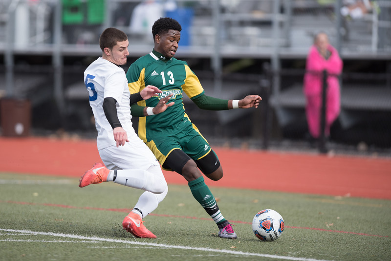 Fitchburg State Freshman junior Ibrahima Male (right) move the ball wide as Worcester State junior Ryan Almeida (left) kicks the ball out of bounds during Sunday's play off finals between Fitchburg State at Worcester State.  Sentinel & Enterprise photo/Jeff Porter