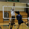 Annie Woolley goes up for a block