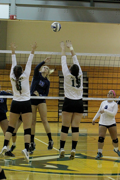 L-R Nicole Sylvester and Clara Watson (Groton) attempt the block