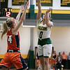 Fitchburg State University women's basketball played Salem State University on Saturday, Jan. 11, 2020 at the FSU's Recreation Center. FSU's #0 Angelina Marazzi puts up a shot over . SENTINEL & ENTERPRISE/JOHN LOVE