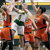 Fitchburg State University women's basketball played Salem State University on Saturday, Jan. 11, 2020 at the FSU's Recreation Center. FSU's #0 Angelina Marazzi is surrounded by SSU's #14 Katie Wallace, #15 Mia Crawley and #23 Liz Zaiter as she tries to get shot off. SENTINEL & ENTERPRISE/JOHN LOVE
