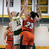 Fitchburg State University women's basketball played Salem State University on Saturday, Jan. 11, 2020 at the FSU's Recreation Center. FSU's #32 Lindsay McDanald tries to get a shot off over SSU's #23 Liz Zaiter. SENTINEL & ENTERPRISE/JOHN LOVE