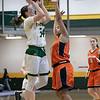 Fitchburg State University women's basketball played Salem State University on Saturday, Jan. 11, 2020 at the FSU's Recreation Center. FSU's #34 Mishelle Logie puts up a shot over SSU's #15 Mia Crawley. SENTINEL & ENTERPRISE/JOHN LOVE