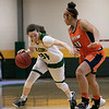 Fitchburg State University women's basketball played Salem State University on Saturday, Jan. 11, 2020 at the FSU's Recreation Center. FSU's #34 Mishelle Logie drives to the basket by SSU's #15 Mia Crawley. SENTINEL & ENTERPRISE/JOHN LOVE