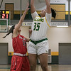 Bridgewater State University girls basketball visited Fitchburg on Wednesday, Jan. 22, 2020 to play Fitchburg State University. FSU's #35 Jadelen Harold puts up a shot over BSU's #12 Nicole Bostick. SENTINEL & ENTERPRISE/JOHN LOVE