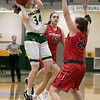 Bridgewater State University girls basketball visited Fitchburg on Wednesday, Jan. 22, 2020 to play Fitchburg State University. FSU's #34 Mishelle Logie puts up a shot over BSU's #24 Hannah Dziadyk. SENTINEL & ENTERPRISE/JOHN LOVE