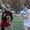 Fitchburg State University women's lacrosse played Regis College on Thursdasy afternoon, March 5, 2020. FSU's #16 Rebecca Fisher tries to stop RC's #3 Kerri Anselmo. SENTINEL & ENTERPRISE/JOHN LOVE