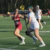 Fitchburg State University women's lacrosse played Regis College on Thursdasy afternoon, March 5, 2020. FSU's #13 Samira El-Hakim and RC's #20 Bella Oliver. SENTINEL & ENTERPRISE/JOHN LOVE