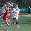Fitchburg State University women's lacrosse played Regis College on Thursdasy afternoon, March 5, 2020. RD's #12 Brookie Ross and FSU's #10 Madison Alves. SENTINEL & ENTERPRISE/JOHN LOVE