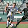 Fitchburg State University men soccer played Framingham State University on Saturday, September 21, 2019 at Elliot Field on campus. FSU's #26 Jeremiah Maki and Framiingham's #20 Kofi Poku. SENTINEL & ENTERPRISE/JOHN LOVE