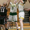 Fitchburg State University women's basketball played Dean College on Tuesday night at the FSU Recreation Center in Fitchburg. DC's #13 Marcenzya Melvinr reaches for a rebound with FSU's #11 Payton Fitzgerald and #34 Mishelle Logie. SENTINEL & ENTERPRISE/JOHN LOVE