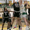 Fitchburg State University women's basketball played Dean College on Tuesday night at the FSU Recreation Center in Fitchburg. FSU's #22 Catheerine Coppinger and #23 Emma Thomson go up for a rebound with DC's #33 Alexah Potter. SENTINEL & ENTERPRISE/JOHN LOVE