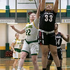 Fitchburg State University women's basketball played Dean College on Tuesday night at the FSU Recreation Center in Fitchburg. DC's #33 Alexah Potter gets a rebound over FSU's #22 Catherine Coppinger. SENTINEL & ENTERPRISE/JOHN LOVE