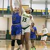 Fitchburg State University womens basketball played Albertus Magnus College on Saturday, Nov. 23, 2019 at the university's Recreation Center. FSU's #35 Jadelen Harold and AMC's #22 Andreah Orr fight for a rebound. SENTINEL & ENTERPRISE/JOHN LOVE
