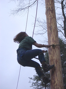 April 23, 2004: WW04 Friday events at Oak Hill.  Dartmouth alumni woman Sarah McCoy runs up the pole.