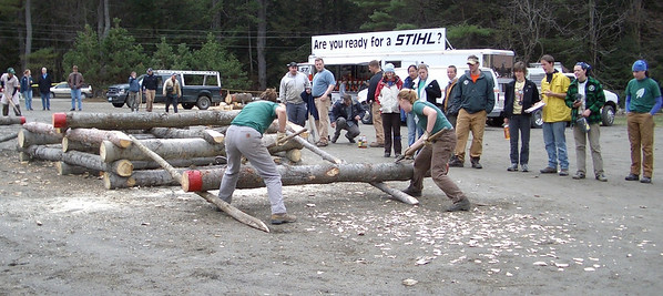 April 23, 2004: WW04 Friday events at Oak Hill.   Dartmouth women's team in the scoot load.  In the background, the display truck brought by meet sponsor Stihl.