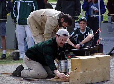 April 24, 2004: WW04 Saturday events on the Green. David Kotz and Tim Burdick building a fire.  (Photo by David Metsky)