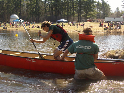 WW2008 at UNH. Dartmouth men's team - singles-canoe exchange.  Josh steadies as Phil gets in.