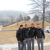 The cadets pause for a photo on a snowy day in front of the USAFA planetarium.