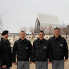 The cadets pose, with the USAFA chapel in the background.