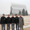 Dr. Grant and the cadets pose, with the USAFA chapel in the background.