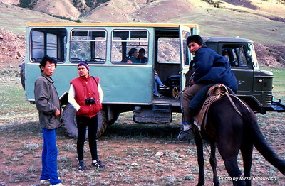 "Zlaja talking to the local people in the evening at the Maida Adyr camp. I love so much those go-anywhere Russian trucks. The local people are warm and outgoing. The boy on the horse invited us to his home. He does not speak any language but we understand somehow that he like to show us his family.  - Zlaja razgovara sa lokalnom ""rajom"", predvece kod Maida Adyr kampa. Domaci Kirgizi su gostoljubivi i otvoreni. Djecak na konju nas je pozvao da posjetimo njegovu porodicu."