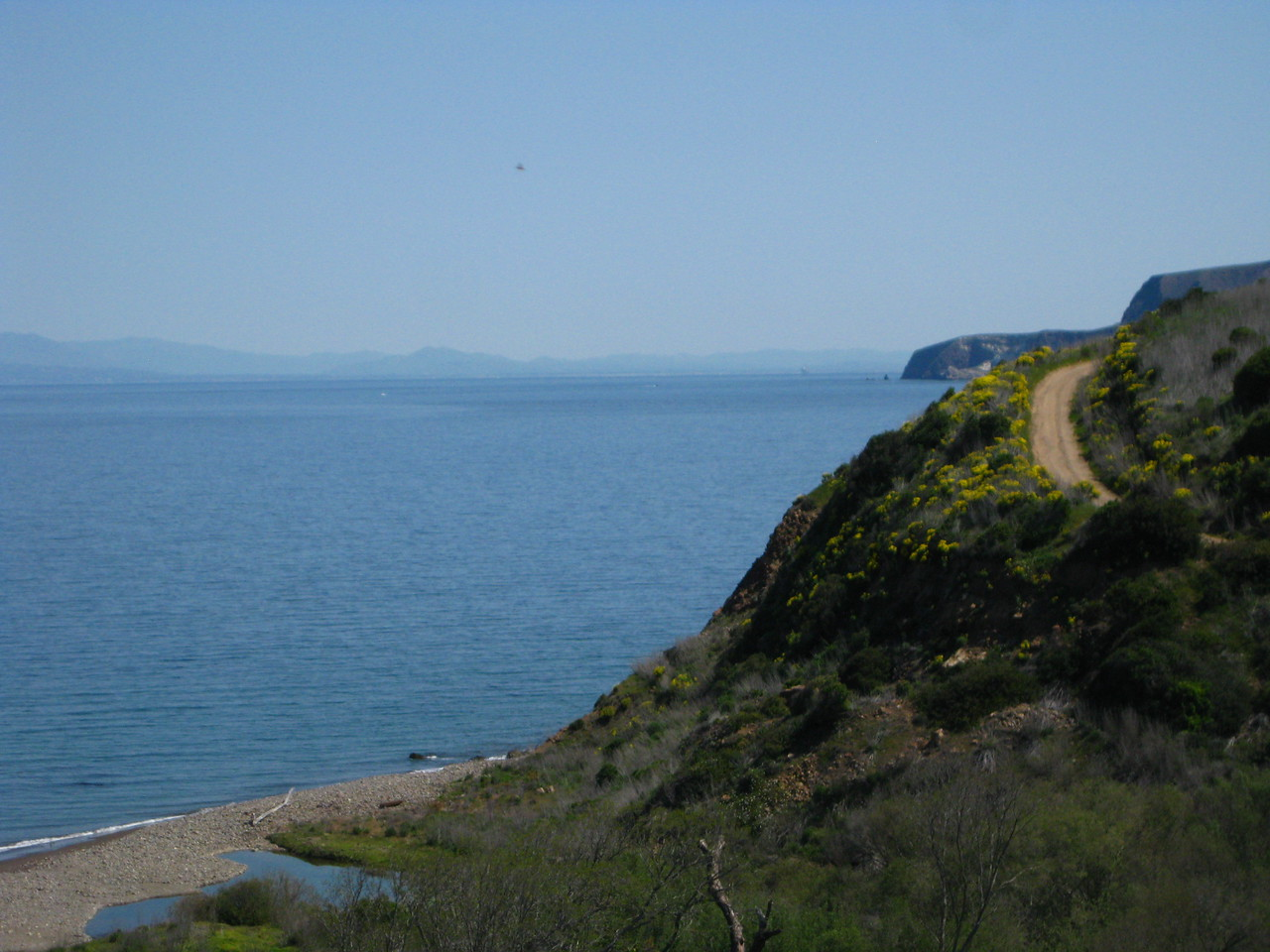 Behind the cliffs far away is Scorpion Ranch landing. Coast with Santa Monica Mountains in the background