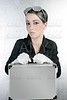 futuristic businesswoman holding silver briefcase
