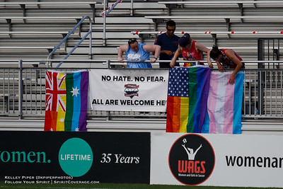 The Washington Spirit supporters group, the Spirit Squadron, hang signs at Maureen Hendricks Field in Boyds, MD, on July 20, 2019 for the Washington Spirit match against the Houston Dash.