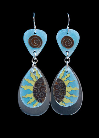 Cloisonné enamel sun earrings. 3 moving pieces.  The enamel suns rest on Argentium silver teardrops.  All findings are fine silver or Argentium silver. Approximately 2 1/2 inches from top of ear wires to bottom of silver teardrop. Lots of movement and sound! 150.00
