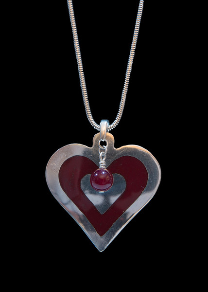 Champlevé heart pendant with opaque crimson enamel. Fine silver heart embedded in the enamel. Approximately 1 3/4 inches from top of bail to tip of heart. All fine silver.  Sterling silver chain is available but not included in cost. 130.00