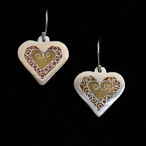 Fine Silver Champlevé and Cloisonné tiny gold heart earrings. Measuring 1 inch long, 3/4 inches wide. Drop from earwire is approximately 1 3/8 inches. Sterling Silver earwires. 95.00