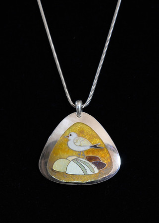 Fine Silver Champlevé and Cloisonné seagull with sunset backdrop. 1 1/2 inches long, 1 3/4 inches at bottom width. Sterling silver bail. Supported on a 16 inch Sterling Silver snake chain. 185.00