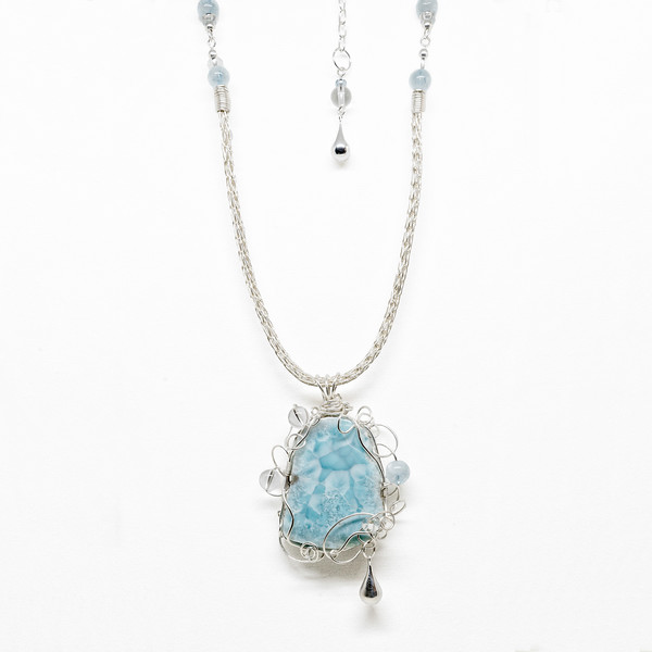 This piece is not in my Etsy store. It incorporates a fabulous slice of Larimar, a Sterling Silver Viking Knit chain, aquamarine and crystal beads. It hangs at about 18 inches. Original cost: 275.00.