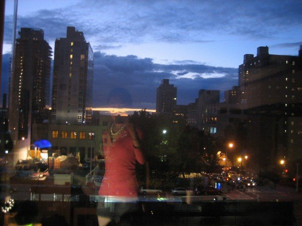 Casey taking a picture out the window of her dorm. Note her reflection in the glass.