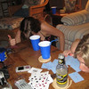 """ i hate kings and the stupid rule that if you break the rules you have to put your chin on the table for the rest of the game!""<br /> <br /> Victoria Schneider and Casey playing a game of kings at the sea isle shore house."