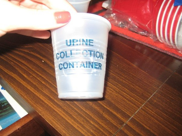 """""""hummm...""""<br /> <br /> haha shot glass in disguise of a urine collection container"""