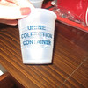 """hummm...""<br /> <br /> haha shot glass in disguise of a urine collection container"