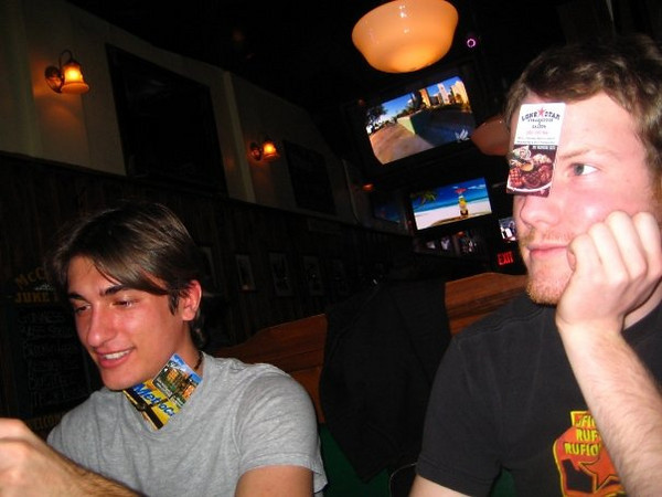 Joel and Pat amuse themselves by going through (and wearing?) the contents of Casey's purse.