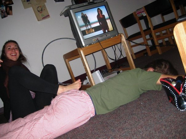 """Janine laying on the floor of 9M waiting for Christina to crack her back, a common occurrence in the apartment. Appreciate """"Real Housewives of New York"""" on the TV in the background!"""
