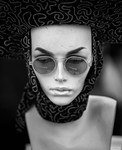 Mannequin With Hat and Glasses