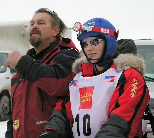 Rachael Scidoris became the first legally blind musher to complete the 1,200-mile Iditarod sled dog race in 2006.  She is seen here at age 20 with her father and manager, Jerry Scidoris, before the official start of the 2005 Iditarod.