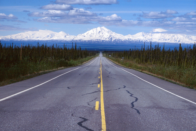 "Alcan Highway, Alaska <FONT FACE=""arial,geneva"" SIZE=""1"" COLOR=SILVER> It's a 5 day, 12 hours a day drive from Seattle to Anchorage Alaska on paved, unpaved and questionable roads.  As Jack London once wrote, ""In the North Country is where I found myself.  There nobody talks.  Everybody thinks.  You get your true perspective.  I got mine.""<br>  Take the drive someday.  You just might enjoy the company.</font>"